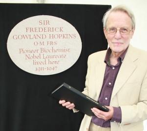 Nicolas Hawkes with a presentation copy of the catalogue