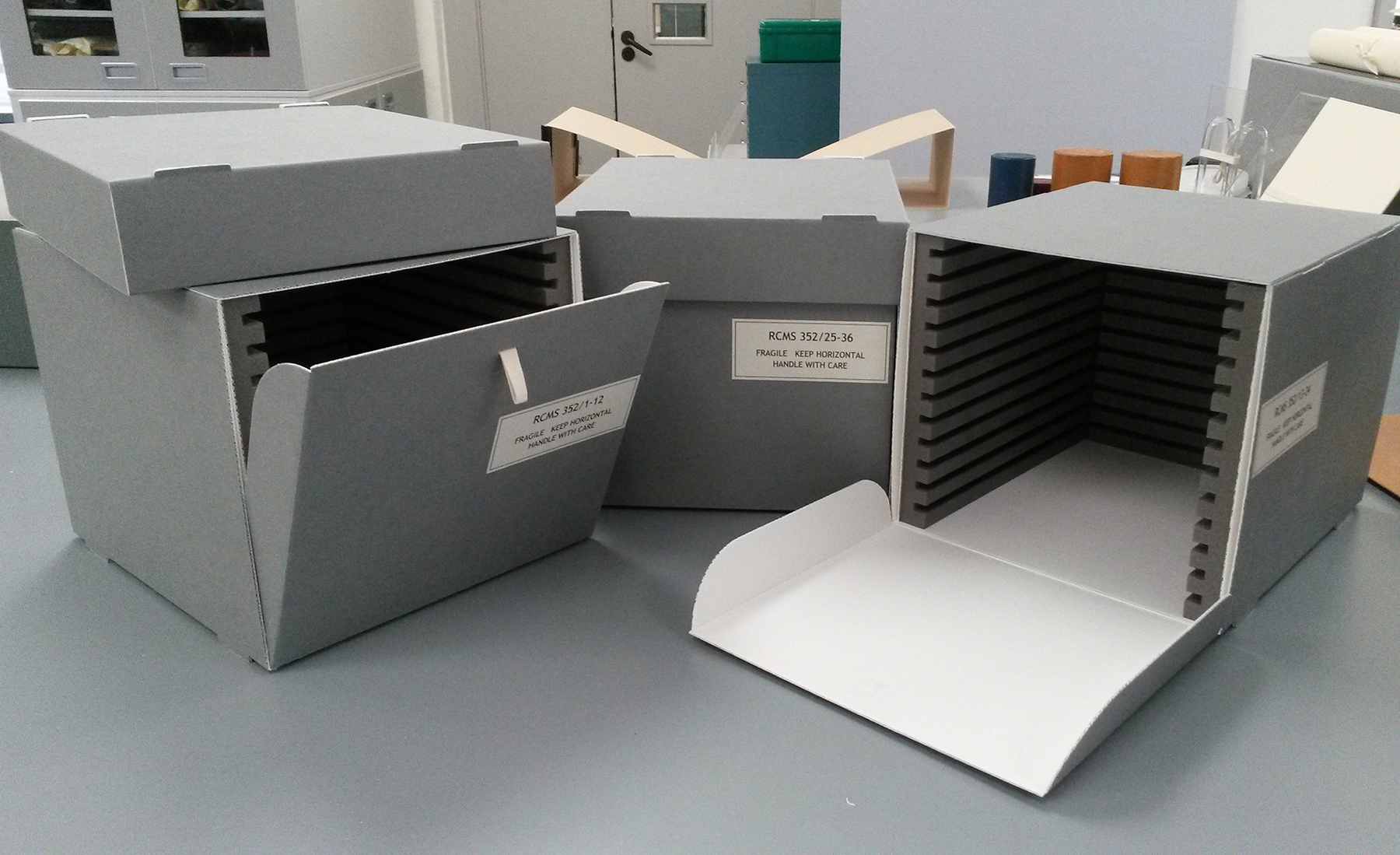 The three boxes with lids, drop front access and plastazote channels