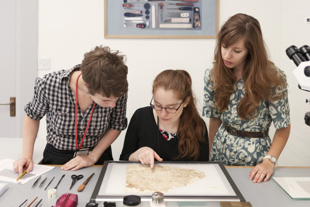 Figure 1: The Lewis-Gibson team discussing a fragment. From left to right, Rebecca Goldie, Mary French, and Emma Nichols