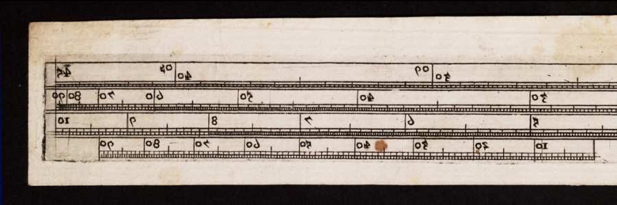 Closeup of one end of the UL slide rule.