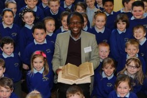 Dr Onesimus Ngundu with Mary Jones' Bible at a Bala primary school
