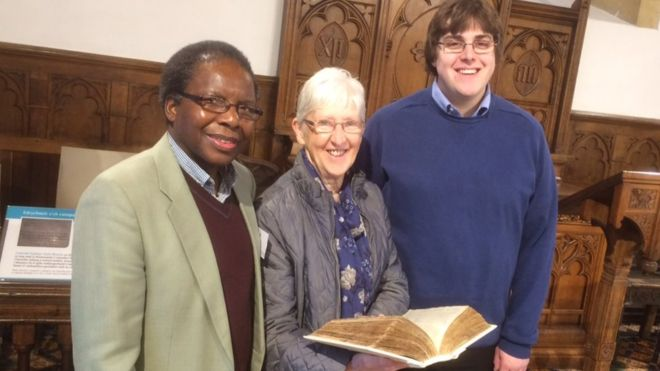 Dr Onesimus Ngundu with Mary Jones' Bible and members of the Bible Society Action group, Bala