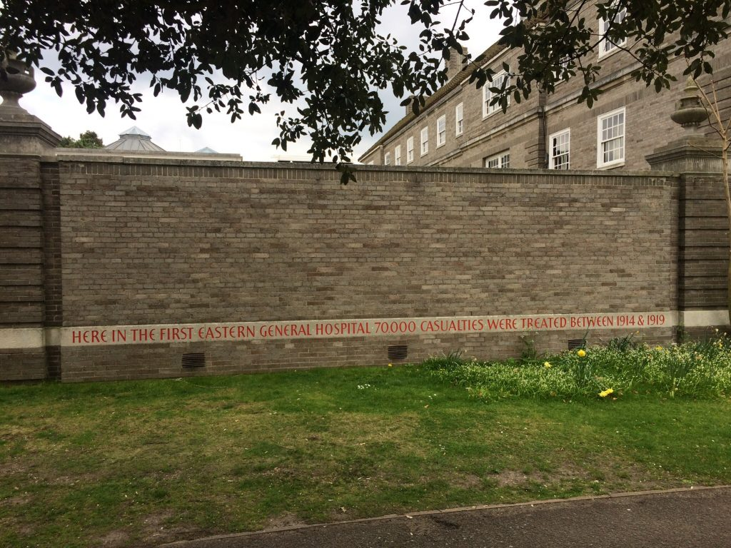 Inscription carved on wall of Clare Court commemorating the First Eastern General Hospital
